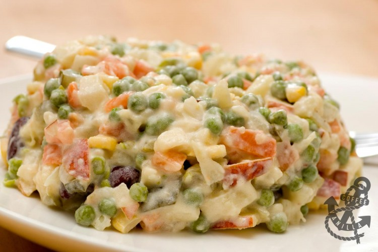 vegetable salad with root veggies peas corn and mayonnaise