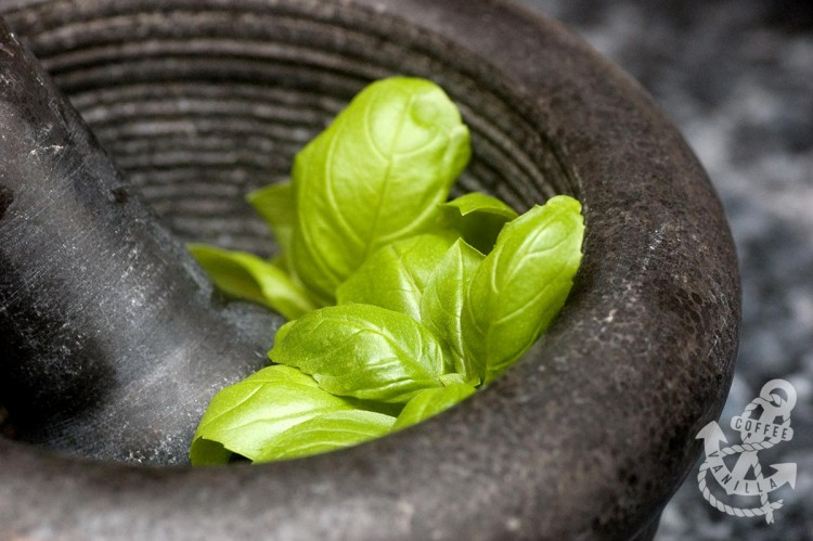 basil leaves in mortar and pestle