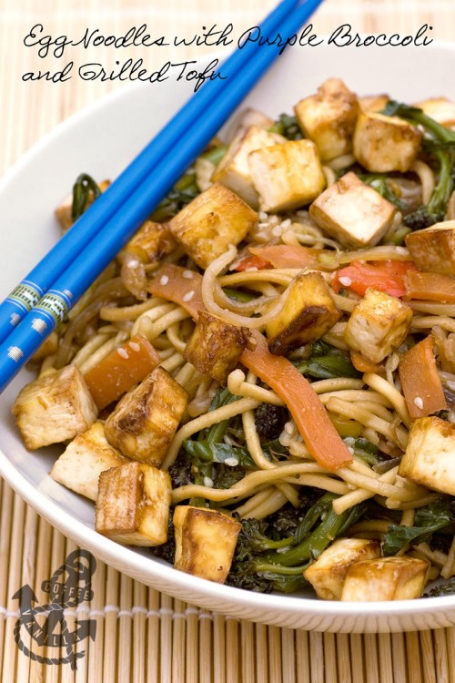egg noodles purple broccoli grilled tofu in a bowl with chopsticks
