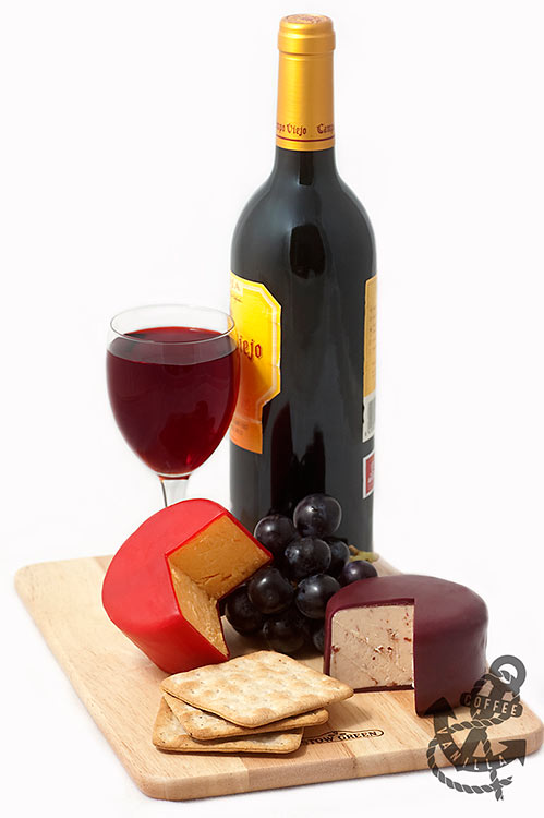 bottle of wine with cheese and crackers