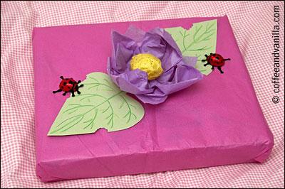 little girl gift wrap tissue flower and lady birds