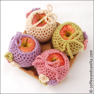 apple cosies with flower motifs