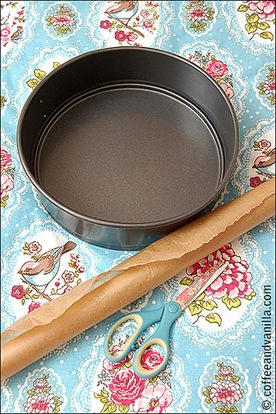 lining loose base cake tin with parchment paper
