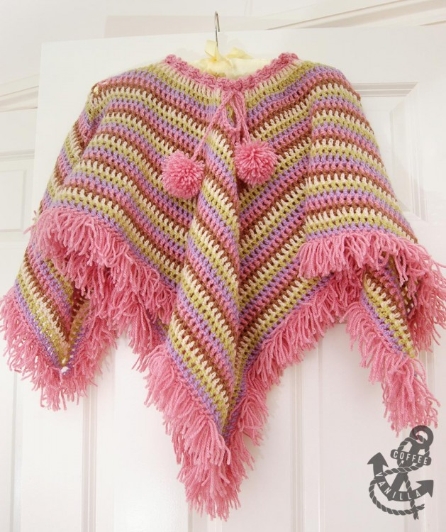 girls poncho cape with pom poms and tear drop corners