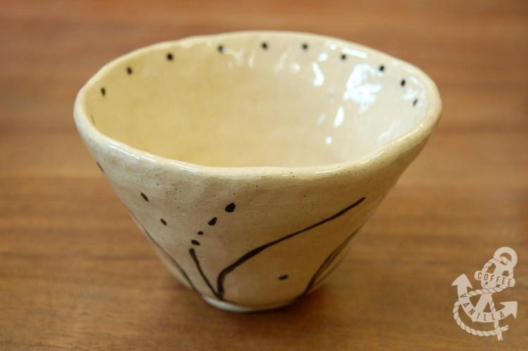 handmade buff clay dish with black design