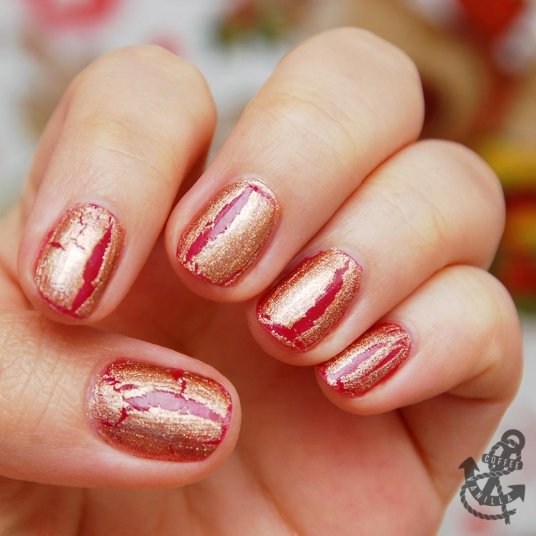 golden crackle nail polish on the top of glossy red base coat