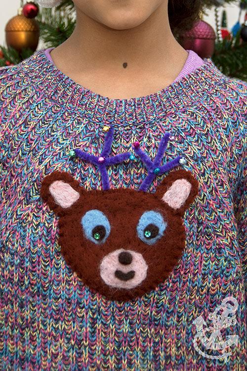 handmade woolly jumper with cute reindeer