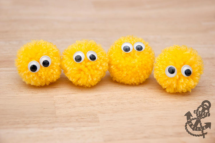cute pom pom creatures with googly eyes