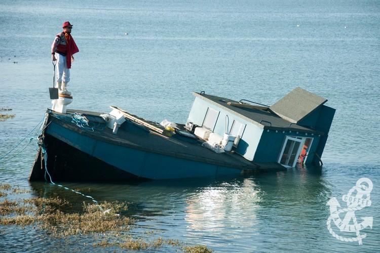 sinking houseboat on Adur River Shoreham by Sea