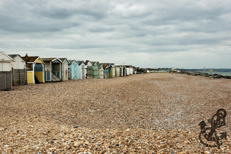 Lancing seafront with shingle beach huts