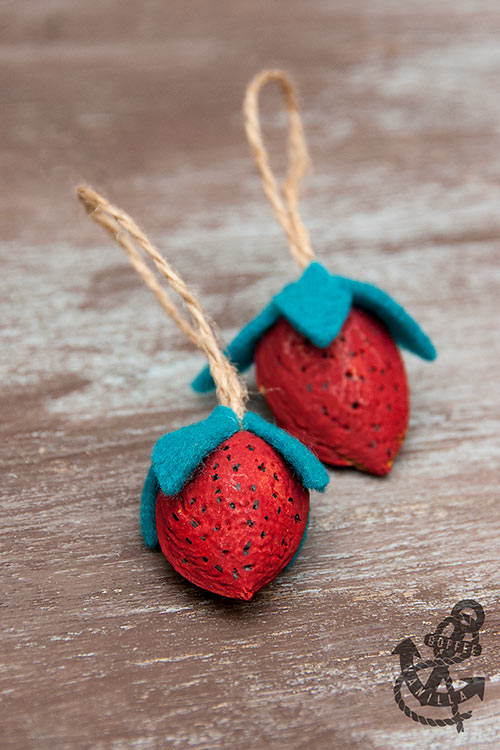 art with nut shells almond walnut strawberries