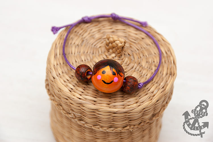 wooden bead bracelet with sliding knot doll face bracelet pendant necklace